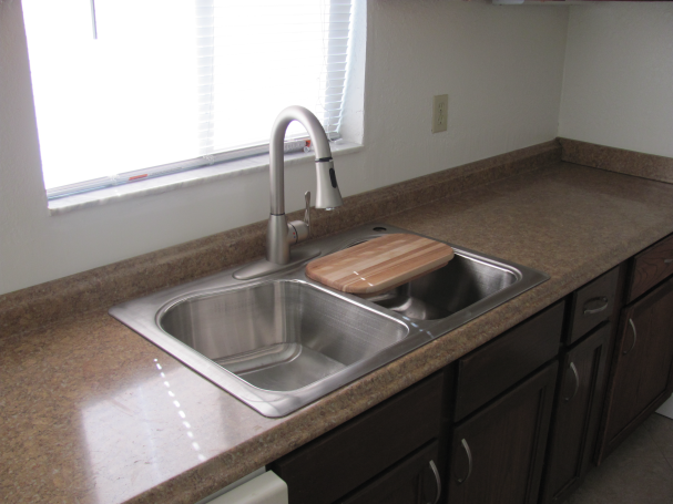 Kitchen Sink Cabinets Updated By Rent Ready Services The Kitchen Sink